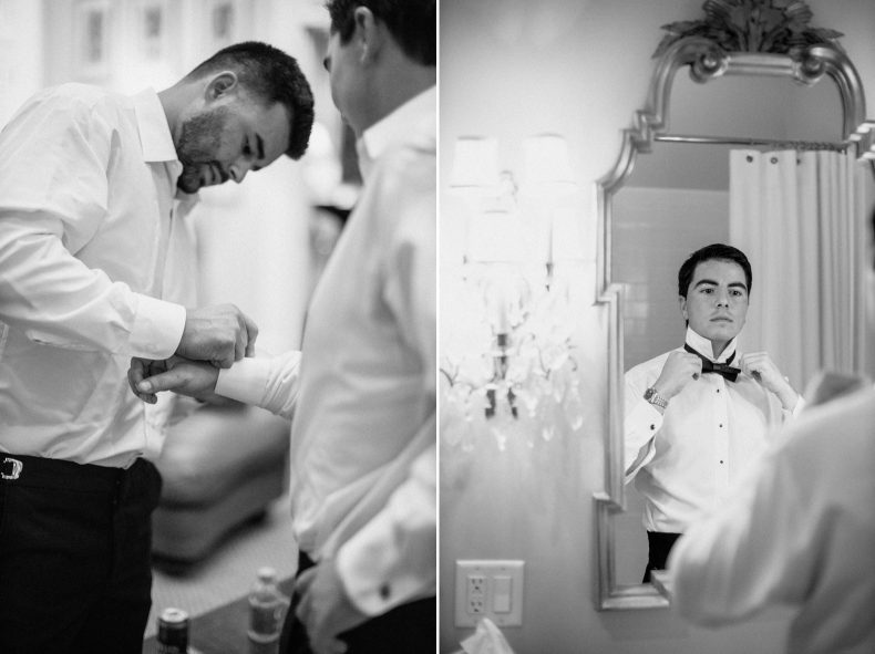 groom tying bowtie in bathroom mirror on right and groomsmen fastening cufflinks on grooms shirt
